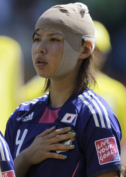 Japan's Kumagai listens to national anthem before Women's World Cup Group B soccer match against New Zealand in Bochum